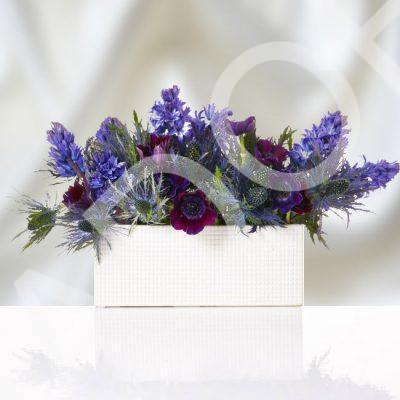 Premium Blue Flowers in Ceramic Container